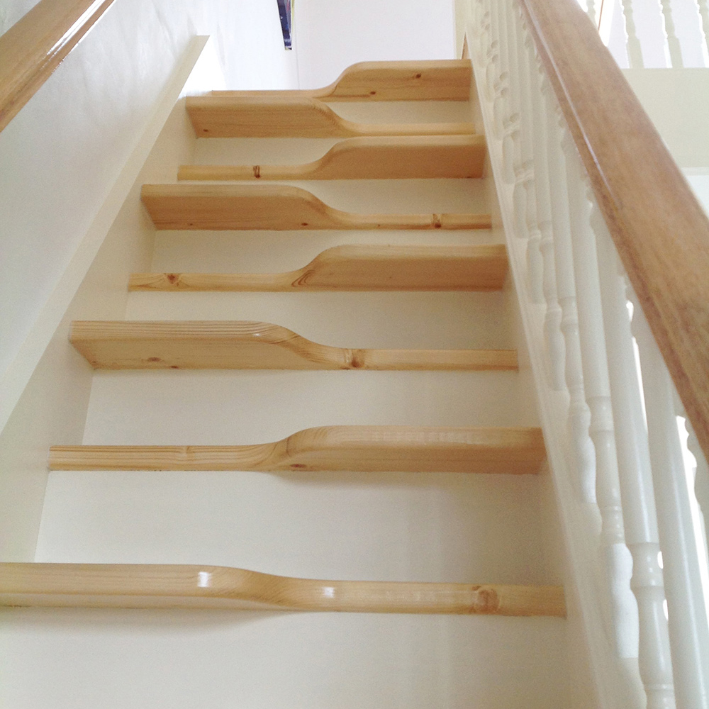 Angled from the bottom of the flight, the oak alternating 'paddle' treads are rise up the flight.